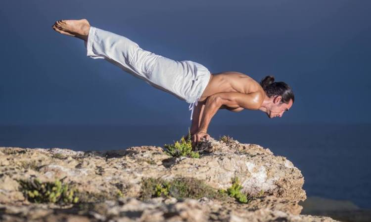 image of balazs heller in yoga balance pose